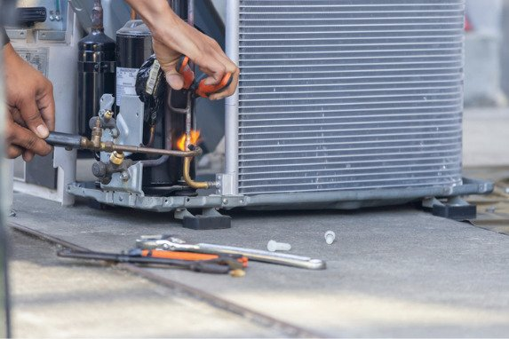 Air conditioner being repaired